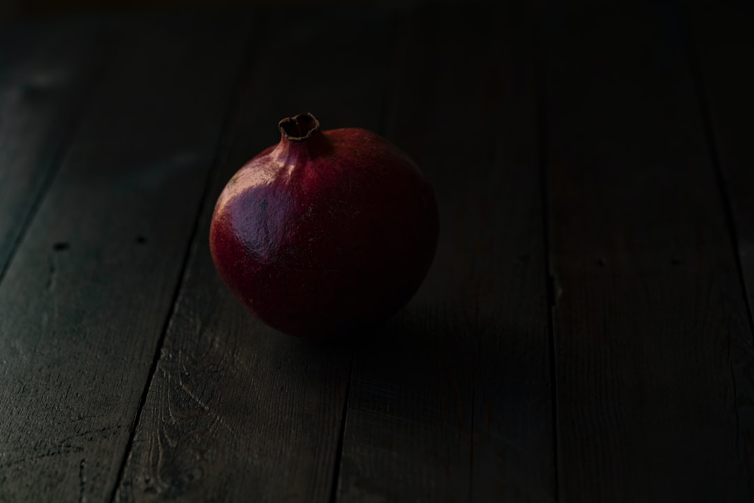 An apple sitting on top of a wooden table